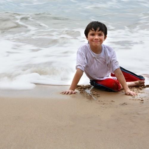 One of the boys of the family on the beach, Sri Lanka