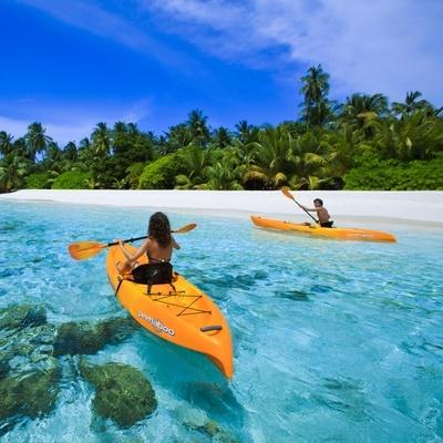 Sea kayaking on the crystal clear Indian Ocean, Angsana Ihuru, Maldives